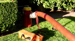 A hose connected to a fire hydrant on fire scene Stock Footage