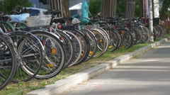 Traveling by bicycle in Europe. Bike parking Stock Footage