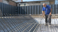 Workers installing reinforcement bars at building construction by Sheyno. Stock Footage