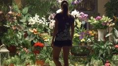 Woman in flower shop choosing bouquet Stock Footage