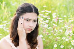 Teen girl thinks about the problems outside Stock Photos