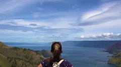 Female traveler enjoying visit at Toba lake in North Sumatra, Indonesia Stock Footage