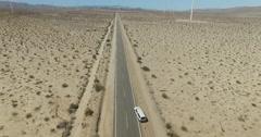 Truck Driving Desert Highway Aerial Stock Footage
