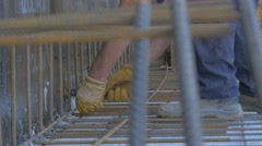 Construction worker tying armature,building construction with pliers by Sheyno. Stock Footage