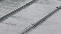 Close-up of iron roof, raindrops falling on housetop, bad rainy weather Stock Footage