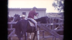 1966: women on horseback riding through an open gate on a farm SOUTH DAKOTA Stock Footage