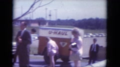 1966: people stopped on the side of the road and gathering around a vehicle  Stock Footage