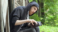 Nervous man sitting outside and calculate money from the wallet Stock Footage