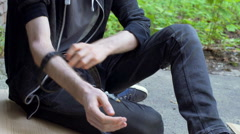 Man using needle with drugs because of his addicition, steadycam shot Stock Footage