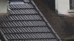 Rainy weather, raindrops flowing down roof tiles, climate change, global warming Stock Footage