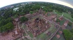 Aerial shot tourists travelling ancient temple Wat Mahathat Ayudhaya, Thailand. Stock Footage