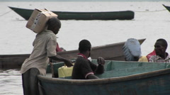 Medium-shot of fishermen and their boats along the shore of Lake Victoria, Stock Footage