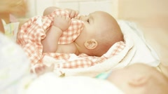 Two Babies Being Dressed Stock Footage