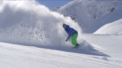 SLOW MOTION: Extreme snowboarder snowboarding in fresh snow doing powder turns Stock Footage