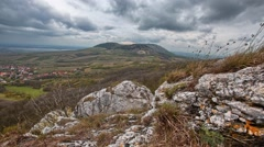 Cloudy time lapse with rock and hill Stock Footage
