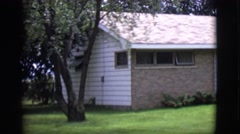 1968: a ranch style house with a green lawn during the day. CLARKSDALE, ARIZONA Stock Footage