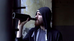 Sad man drinking wine alone and looking to the camera, steadycam shot Stock Footage