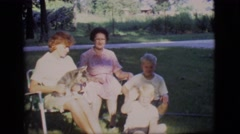 1968: timeout with the kids having fun with the pet because daddy  Stock Footage