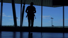 Young man with a backpack standing at ufa airport lounge  Stock Footage