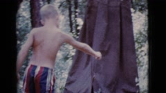 1968: topless kid is seen with a fish COTTONWOOD, ARIZONA Stock Footage