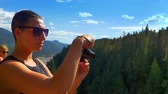 4K Woman with Camera Taking Pictures from Mountain Peak Landscape Tourist Travel Arkistovideo
