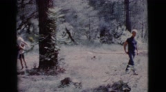 1968: two boys playing on a rope swing hanging from a tree COTTONWOOD, ARIZONA Stock Footage