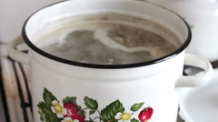 Pan with broth covered with a lid Stock Footage