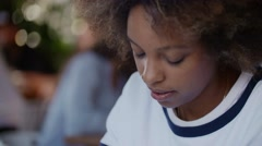 Portret young alone beautiful black woman student overwhelmed by her homework in Stock Footage