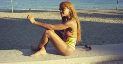 Young woman relaxing at the seaside Stock Footage