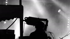 Cameraman on stage shooting on guitarist. Thick smoke. B&W optimization. Stock Footage