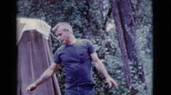 1968: with the task completed he dusts his hands and then takes a bow. Stock Footage