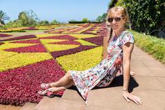Dutch woman as tourist in botanical garden Stock Photos