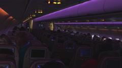 Night Dark Airplane Cabin. Seat Monitors Stock Footage