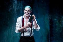 Bloody Halloween theme: crazy joker face Stock Photos