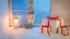 Christmas gifts moving on white table by blue frozen window Stock Footage