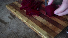Cutting beet on a board chef cooking Stock Footage