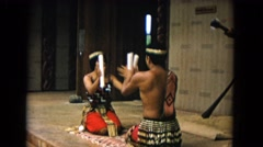 1968: indians sitting around making great music while on there knees HAWAII Stock Footage
