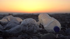 Plastic bag and plastic bottle at a beach Stock Footage
