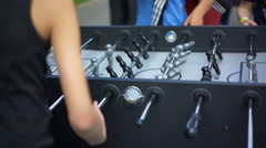 Young boys actively playing table football, happy childhood, active lifestyle Stock Footage