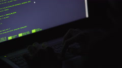 Cyberextortion, professional hacker attacking server at night, computer crimes Stock Footage