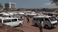 Establishing shot of a crowded bus depot in Kampala, Uganda. Stock Footage