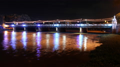 The bridge over the river at night.Chiangmai,Thailand Stock Footage
