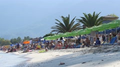 Greece, Thassos, Golden beach - people rest swimming and sunbathing Stock Footage