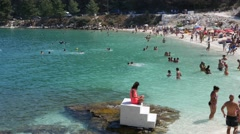 Greece, Thassos, Marble beach - people swimming and sunbathing Stock Footage