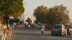 Boulevard of Greek fishing village during Golden Hour Stock Footage