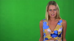 Young pretty blond woman is angry - green screen - studio  Stock Footage