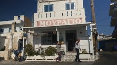 Little fish restaurant in Greek island village. Stock Footage
