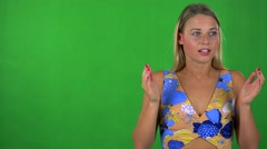 Young pretty blond woman is suprised - green screen - studio  Stock Footage