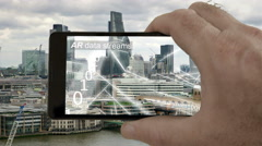 AR phone app showing streams of binary data flying round London. Stock Footage