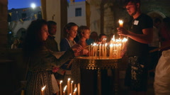 Greeks lighting candles on Assumption Day. Stock Footage